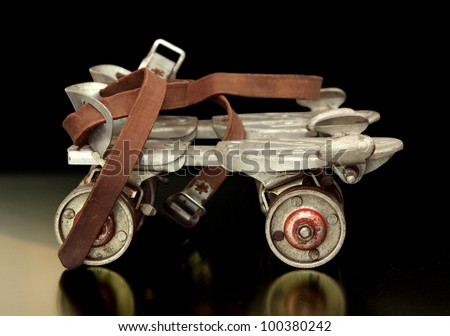 Really old sidewalk skates; the kind you had to put on with a key back in the 40's. - stock photo