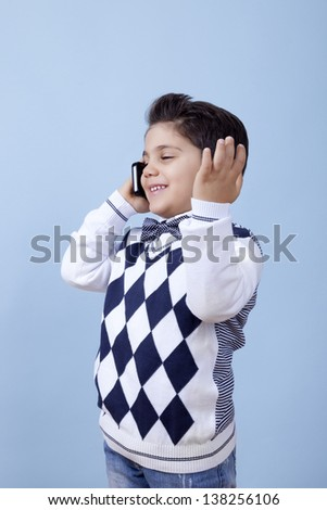 Really young businessman is talking over the phone with his client. - stock photo