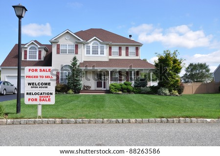 Realtor Relocation For Sale Sign on Beautiful Suburban Landscaped Home under Blue Sky with Clouds in Residential Neighborhood