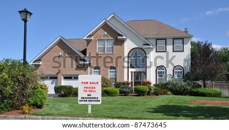 Realtor Short Sale For Sale Sign on Landscaped Front Yard Lawn in Residential District on Blue Sky Sunny Day - stock photo