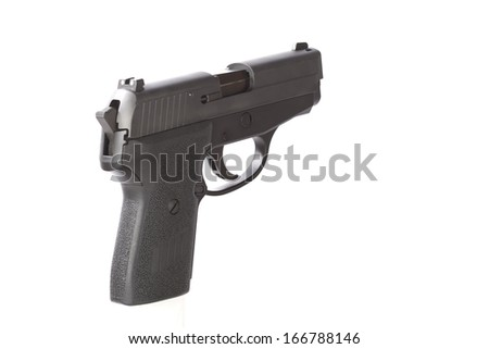 Rear angle view of a 40 caliber handgun. Shot against a white background.