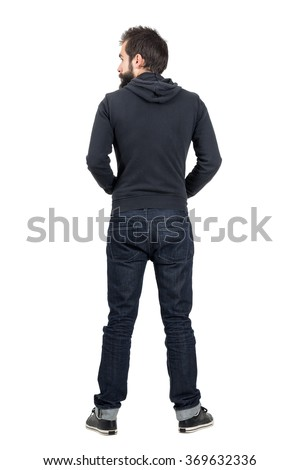 Rear back view of bearded man in black hooded sweatshirt looking away. Full body length portrait isolated over white studio background.  - stock photo