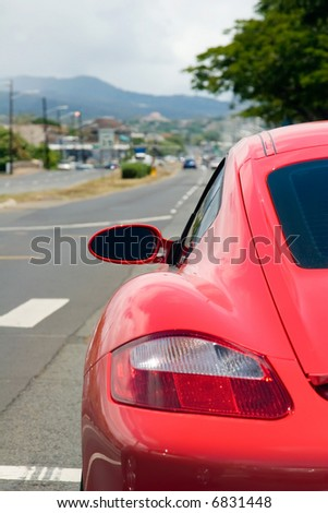 Rear end of a German Porsche driving along a street - stock photo