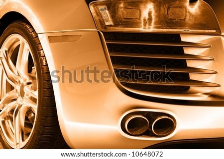 Rear end of a sports-car - stock photo