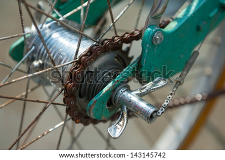 Rear hub of old bicycle with a rusty chain - stock photo