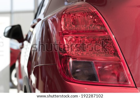 Rear light of a red modern car  - stock photo
