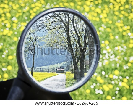 rear mirror at a motorcycle - stock photo