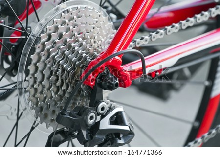 Rear mountain bike cassette with chain close up - stock photo