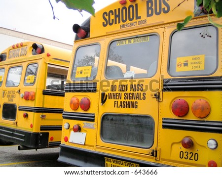 rear part of parked school buses - stock photo