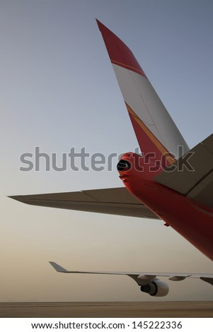 Rear part of stationary airplane - stock photo