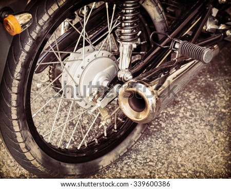 Rear side and understructure of motorcycle on old paper background - stock photo