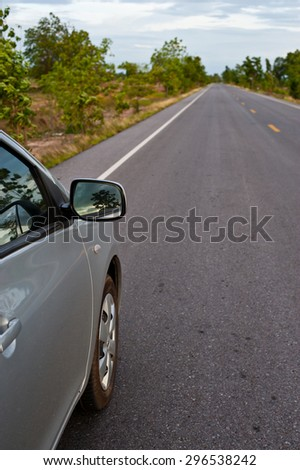 Rear side perspective view of car on road countryside