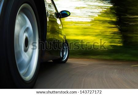 Rear side view of luxury sedan. - stock photo