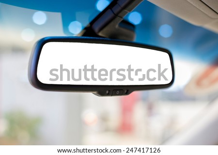 Rear view mirror in the car - stock photo