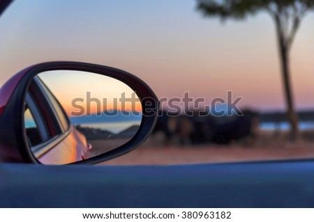 Rear View Mirror Reflection on sun down - stock photo