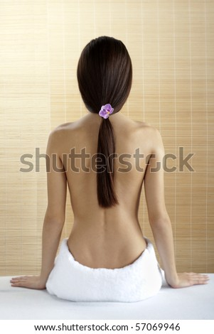 Rear view of a beautiful woman at spa - stock photo
