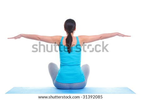 Rear view of a brunette woman sat on a yoga mat with her arms out in a balance position. Isolated on a white background. - stock photo