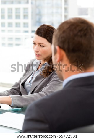 Rear view of a businessman during an interview with a female manager in her office - stock photo