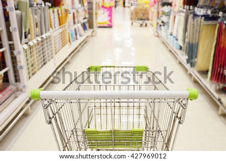 Rear View of a Cart When Shopping in Supermarket. Select Focus
