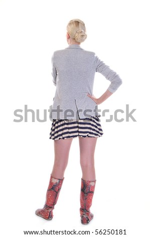 Rear view of a casually dressed young adult woman, isolated on white. - stock photo