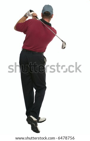 Rear view of a golfer during his back swing. - stock photo