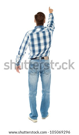 Rear view of a male indicating towards copy space isolated over white background - stock photo