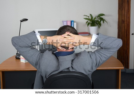 Rear view of a man at office