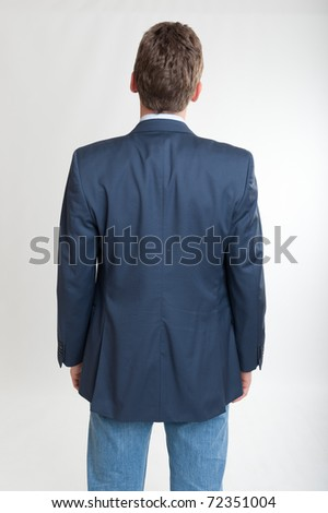 Rear view of a man looking at something - stock photo