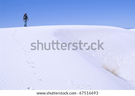 Rear view of a man walking alone on White Sands National Monument, New Mexico, USA
