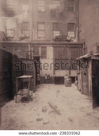 Rear view of a New York City tenement, 134 1/2 Thompson Street, New York City, photograph by Lewis Wickes Hine, February, 1912 - stock photo