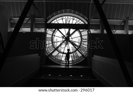 Rear view of a person looking at the inside of a clock tower, Paris, France (black and white), - stock photo