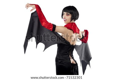 Rear view of a very sexy vampire woman. Isolated on pure white background. - stock photo