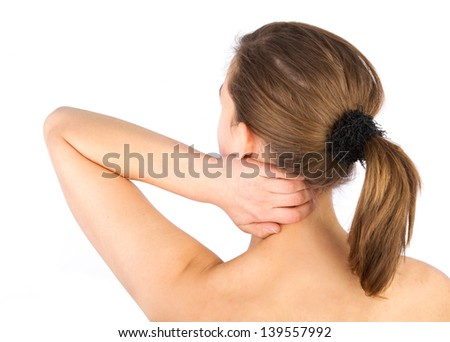 Rear view of a woman with pain in her neck and shoulder, Isolated over white background. - stock photo