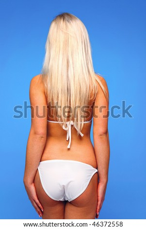 Rear view of a young blond woman wearing a white bikini