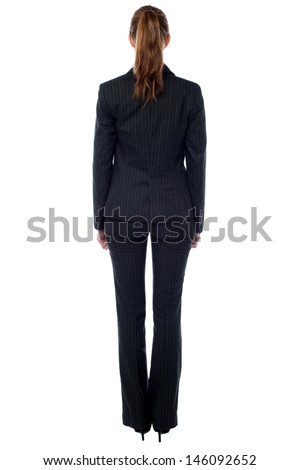 Rear view of a young corporate woman