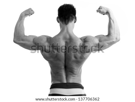 Rear view of a young man flexing his arm and back muscles - stock photo