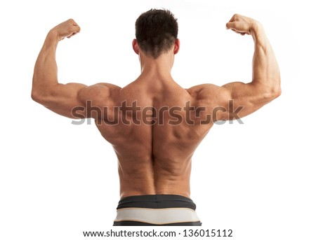 Rear view of a young man flexing his arm and back muscles over white background - stock photo
