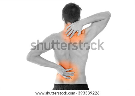 rear view of a young man holding his back in pain, isolated on white background - stock photo
