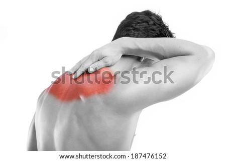 Rear view of a young man with back pain - stock photo