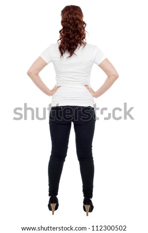 Rear view of a young woman over white background - stock photo