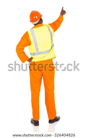 rear view of african contractor pointing at empty space on white background - stock photo