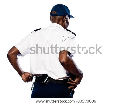Rear view of afro American police officer pulling out handcuffs in studio on white isolated background - stock photo