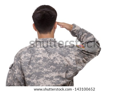 Rear view of an American soldier saluting  - stock photo