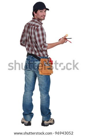 Rear view of an electrician - stock photo