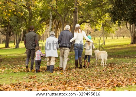 Rear view of an extended family on an autumns day - stock photo