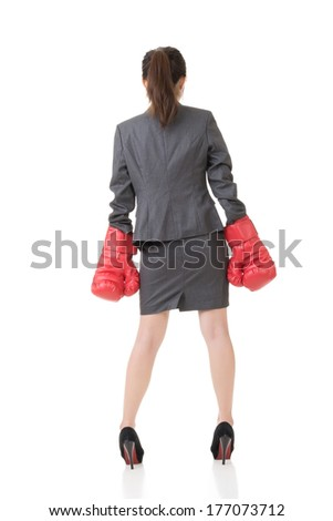 Rear view of Asian business woman with boxing gloves, full length portrait isolated on white. - stock photo
