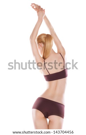 Rear view of beautiful caucasian woman in sport wear, isolated on white background - stock photo