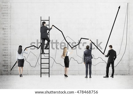 Rear view of business team against graphs on concrete wall. Concept of business development and team work