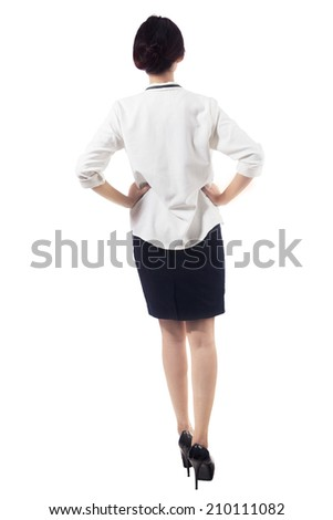 Rear view of business woman walking towards ahead - stock photo