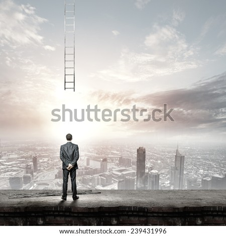 Rear view of businessman and broken ladder going up - stock photo